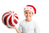 Boy holding a large red Christmas bauble with glitter swirls poster