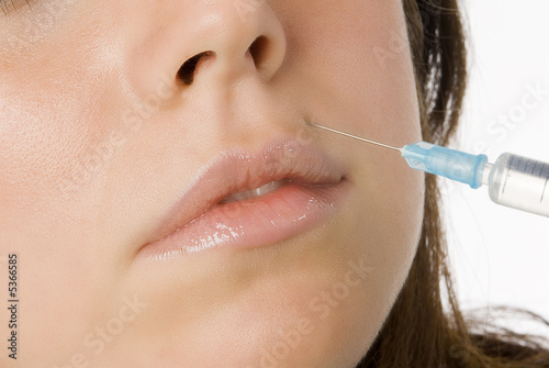 Portrait of fresh and beautiful woman getting botox injection