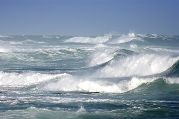 Large ocean waves breaking on a stormy day