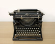 Retro typewriter on a desk - space for text above