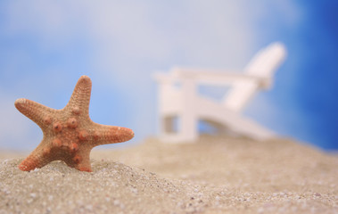 Starfish on Sand With Chair and Blue Sky Background, Shallow DOF