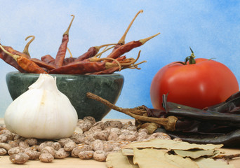 Spices With Garlic and Peppers on Blue Textured Background