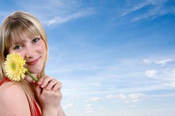 girl smilling with a flower