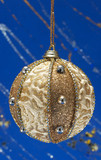 Festive Christmas hanging ball on blue background with sparkles poster