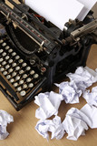Typewriter with paper scattered - conceptual image poster