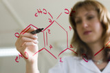 woman writing organic formula poster