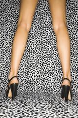 Caucasian female legs wearing high heels.