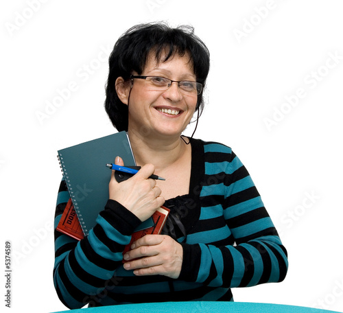 female techer sitting on the table with books, isolated
