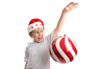 Eenchanted child holding an oversized Christmas bauble