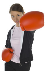 Young beauty with boxing gloves. Trying to hit somebody.