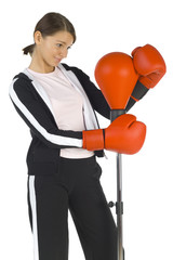 Young beauty with boxing gloves
