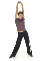 Young, happy woman stretching and looking at camera