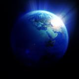 Naklejka Kula ziemska przy wschodzie słońca