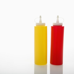 Plastic ketchup and mustard containers.