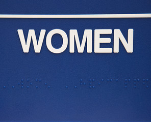 Women sign with braille.