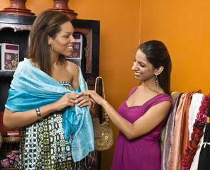 Women shopping together in boutique.
