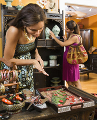Women shopping  in boutique.
