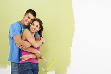 Smiling couple painting.