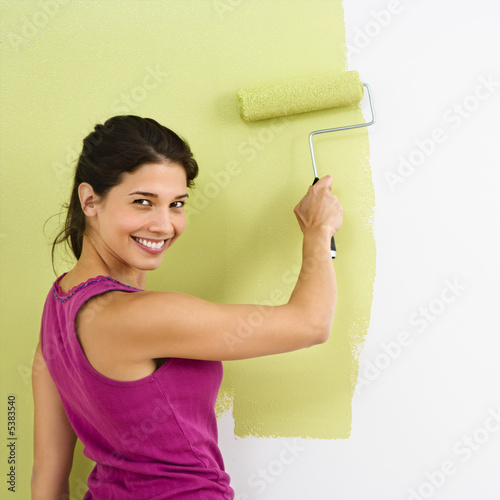 Happy woman painting.