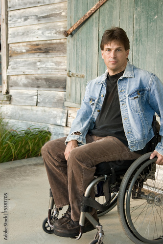 man in wheelchair with determined look