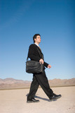 Businessman carrying his laptop case poster