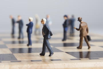 Business figurines placed on chessboard