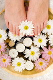 Daisies, candles and pedicured feet poster