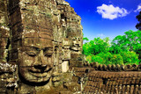 Huge carved face in ruins of temple in Cambodia