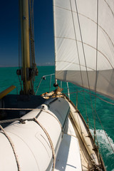 sailing on calm turquoise sea with blue sky