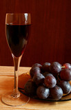 Red wine and grapes. Cuisine and food image. poster