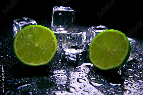Lime fruits with ice cubes - 5390707