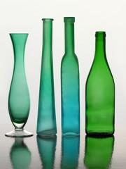 green glass vases and bottles