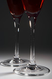 Two beautiful brilliant glasses with red wine poster