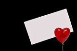 Clip with a heart holding a white sheet of paper