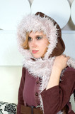 Young woman wearing a burgundy coat, with a fuzzy white hood. poster