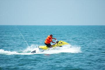 Man driving a motorised scooter at sea