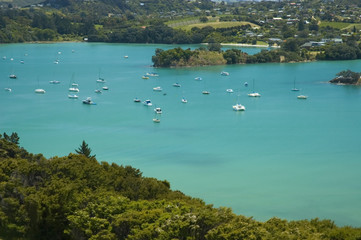 Idyllic view on yachts and boats standing in blue lagoon.