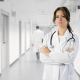 cute brunette in medical gown  and a stethoscope in an hospital