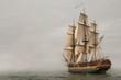 Leinwanddruck Bild - Vintage Frigate sailing into a fog bank