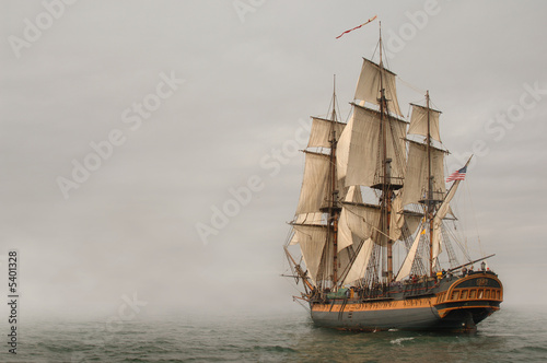Leinwanddruck Bild Vintage Frigate sailing into a fog bank
