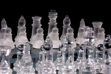 Chess Game - Chess Pieces on a glass chessboard