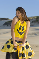 Pretty girl being playful in a yellow polka dot outfit