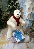 model of a polar bear with christmas box poster