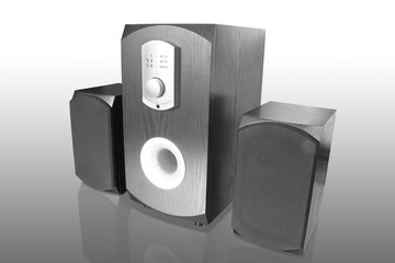 three black computer speakers with built in amplifier