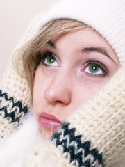 Closeup of young beautiful girl, wearing  hat and gloves