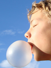 Boy with chewing gum bubble 1