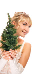 Beautiful blond girl holding a Christmas tree