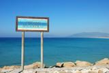 Sign for the Atlantic Ocean in Tarifa, southern Spain poster