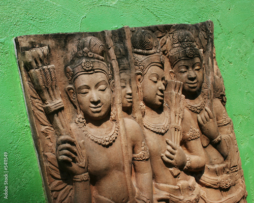 Traditional Thai stone carving on a wall - travel and tourism.