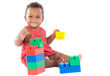 Baby girl playing with building blocks over white background